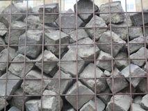 Piedras del adoquín en una jaula Fotos de archivo libres de regalías