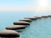 Piedras del flotador con la viga del sol imagen de archivo