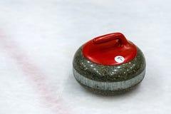 Piedras del granito para el juego que se encrespa en el hielo Imagenes de archivo