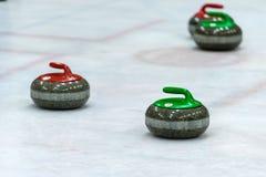 Piedras del granito para el juego que se encrespa en el hielo Foto de archivo