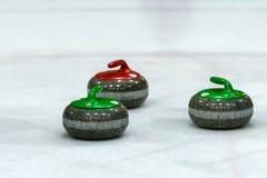 Piedras del granito para el juego que se encrespa en el hielo Fotos de archivo