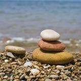 Piedras del zen en la playa Imagen de archivo