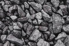 Piedras en la tierra en las montañas Fondo de piedra gris imagen de archivo