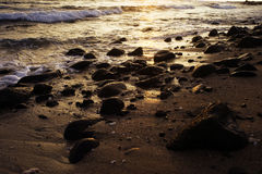 Piedras en puesta del sol Fotografía de archivo