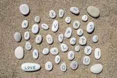 Piedras en un fondo de la arena Fotos de archivo libres de regalías