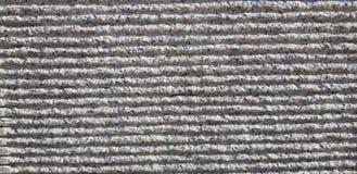 Piedras grises con el fondo rayado de la textura fotografía de archivo