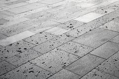 Piedras grises, embaldosado urbano del camino Textura del fondo Fotografía de archivo