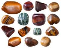 Piedras preciosas del ojo del diverso tigre (Tigereye) aisladas Imagenes de archivo