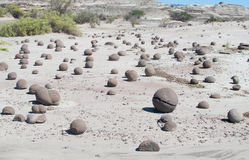 Piedras redondas en la tierra Foto de archivo libre de regalías