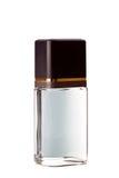 Piedras y botella con perfume Foto de archivo libre de regalías