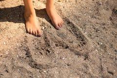 Pieds dans le sable Photo libre de droits