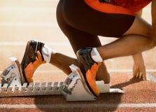 Pieds de sprinter photo stock