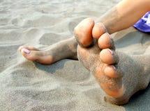 Pieds en sable Photographie stock libre de droits