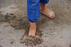 Pieds en sable Images libres de droits