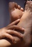 Pieds et mains Photographie stock libre de droits