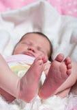 Pieds et orteils de bébés Image stock