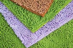 Pieds natte ou tapis de nettoyage pour propre vos pieds Photographie stock