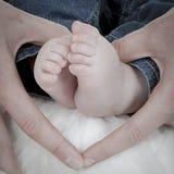 Pieds nouveau-nés Images stock