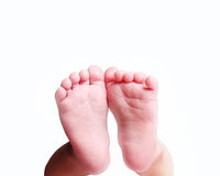Pieds nouveau-nés de bébé Photos stock