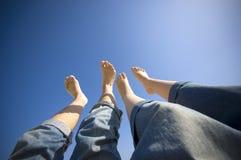 Pieds nus dans le ciel Photographie stock libre de droits