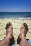 Pieds sur la plage Photo libre de droits