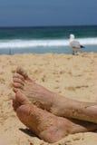Pieds sur le sable Photos libres de droits