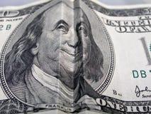 Piegato cento fatture del dollaro Fotografie Stock