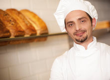 Piekarnia właściciel ubierający w szefa kuchni ubiorze Fotografia Stock