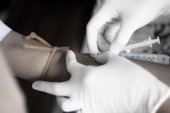 Pielęgniarki ukłuta krew Zdjęcie Royalty Free