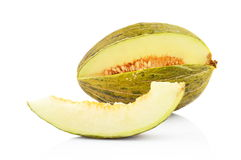 Piel de sapo green melon with slice isolated white Royalty Free Stock Photo