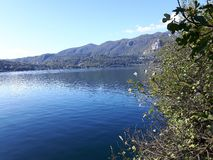 Lake D`orta in autumn days. Piemonte, italy - 12/05/2018: Amazing trip in Piemonte with an incredible view to the lake D`orta in autumn days and a caption of stock photo