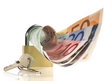 Pieniądze - metalu kędziorek z kluczem obraz stock