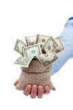 Pieniądze dawać ty jako dotacja lub prezent fotografia royalty free