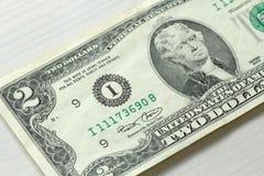 Pieniądze fotografia Dwa dolara z jeden notatką Zdjęcia Royalty Free