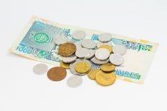 Pieniądze i moneta na białym tle Zdjęcie Stock