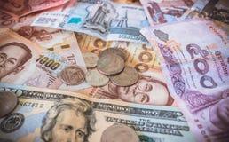 Pieniądze i monety różni stany Obraz Stock