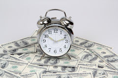 Pieniądze i zegar Obraz Stock