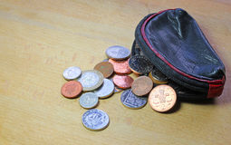 Pieniądze lub gotówka rozlewający od kiesy Obraz Stock