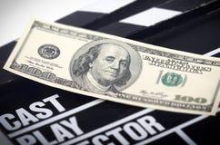 Pieniądze na filmu clapper fotografia royalty free
