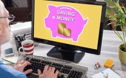 Pieniądze oszczędzania pojęcie na komputerze zdjęcie stock