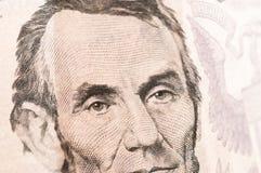Pieniądze pięć Lincoln Dolarowy Bill Obraz Stock
