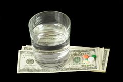 pieniądze pigułki Zdjęcie Royalty Free