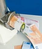 Pieniądze przybycie w maszynka do mięsa i przychodzący out Fotografia Stock