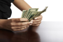 pieniądze ręczny przekalkulowanie fotografia stock
