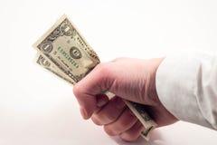 Pieniądze w jego ręce Zdjęcia Royalty Free