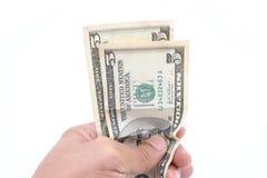 Pieniądze w ręce na bielu zdjęcie stock