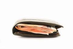 Pieniądze w rzemiennej kiesie odizolowywającej na białym tle Obrazy Royalty Free