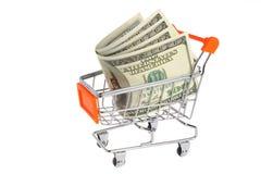 Pieniądze w wózek na zakupy odizolowywającym na bielu Zdjęcia Stock