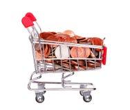 Pieniądze w wózek na zakupy odizolowywającym na bielu Obraz Stock