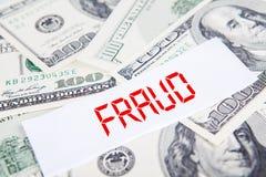 Pieniądze z oszustwo tekstem fotografia royalty free